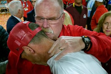 Photo of Kansas City Chiefs head coach Andy Reid, rear, putting his arm around San Francisco 49ers head coach Kyle Shanahan