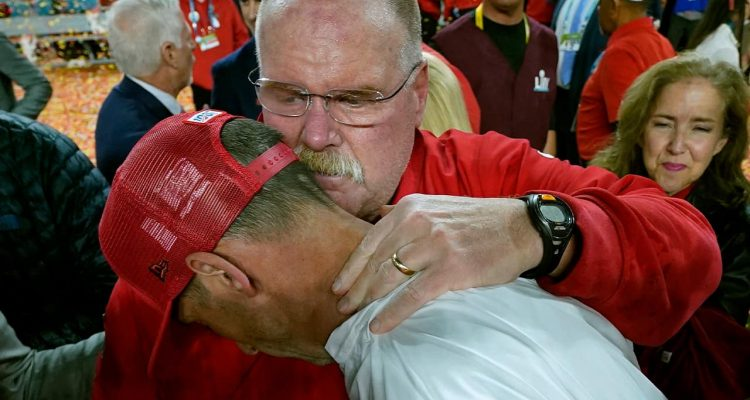 Photo of Kansas City Chiefs head coach Andy Reid, rear, putting his arm around San Francisco 49ers head coach Kyle Shanahan