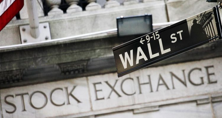 Photo of Wall Street sign in front of the NYSE