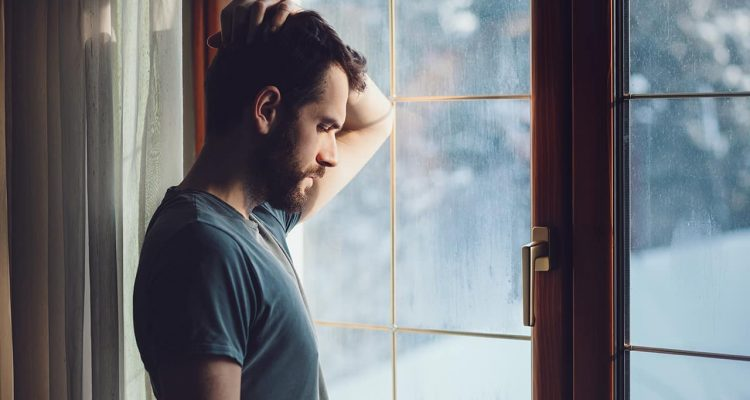 Photo of a man staring out the window