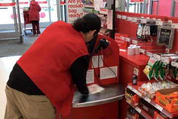 Northwest Fresno Target employee cleans register