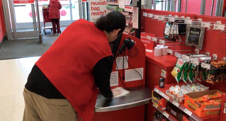 Northwest Fresno Target employee cleans register