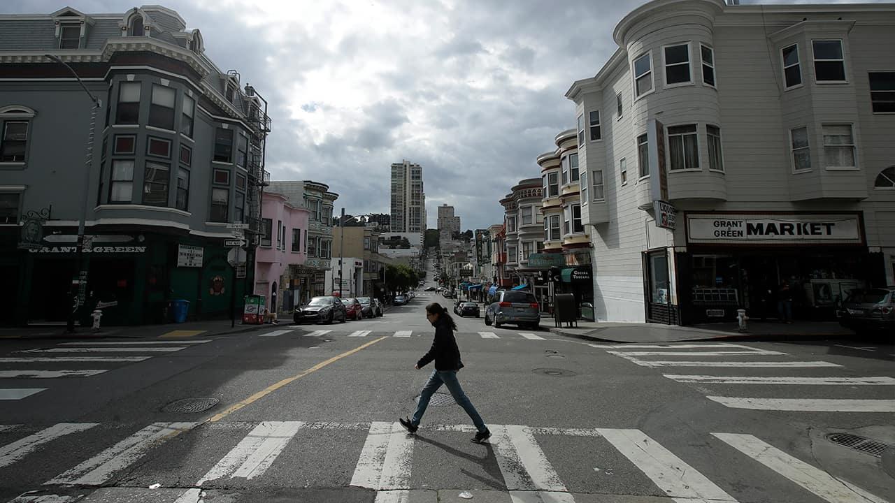 Photo of a man walking in San Francisco
