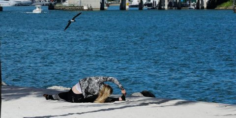 Photo of a woman working out at the beach in Miami
