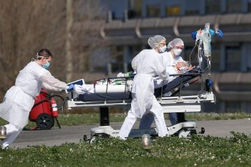 Photo of a victim being evacuated from a hospital in France
