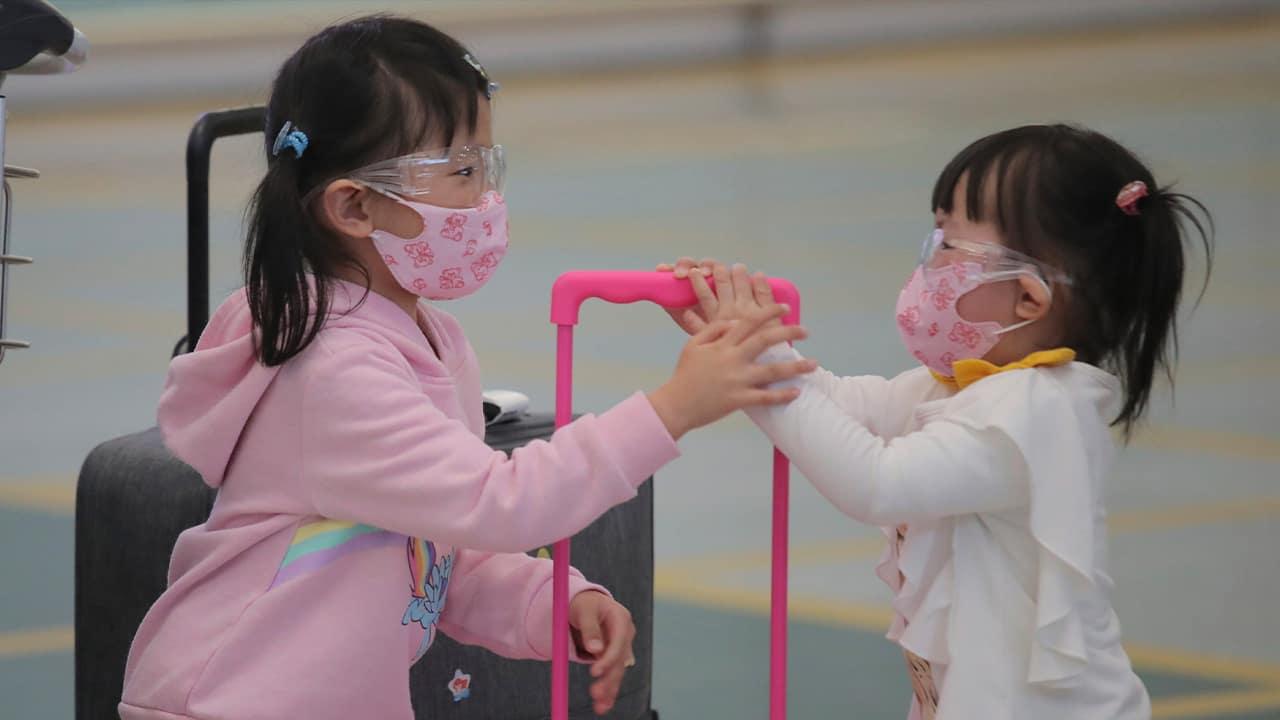 Photo of kids at the Hong Kong airport