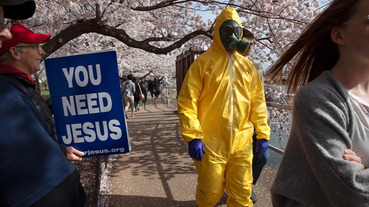Photo of a teenager wearing a hazmat suit