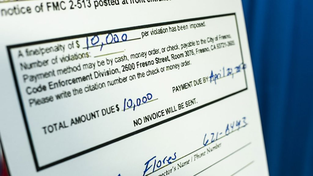 Enlargement of city of Fresno citation showing $10,000 fine issued to Super V Liquor for alleged price gouging.