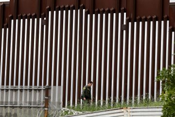 Photo of border wall separating Tijuana and San Diego