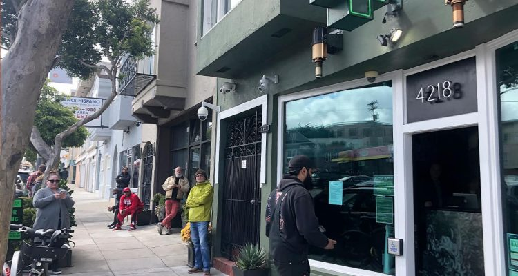 Photo of people waiting outside The Green Cross in San Francisco