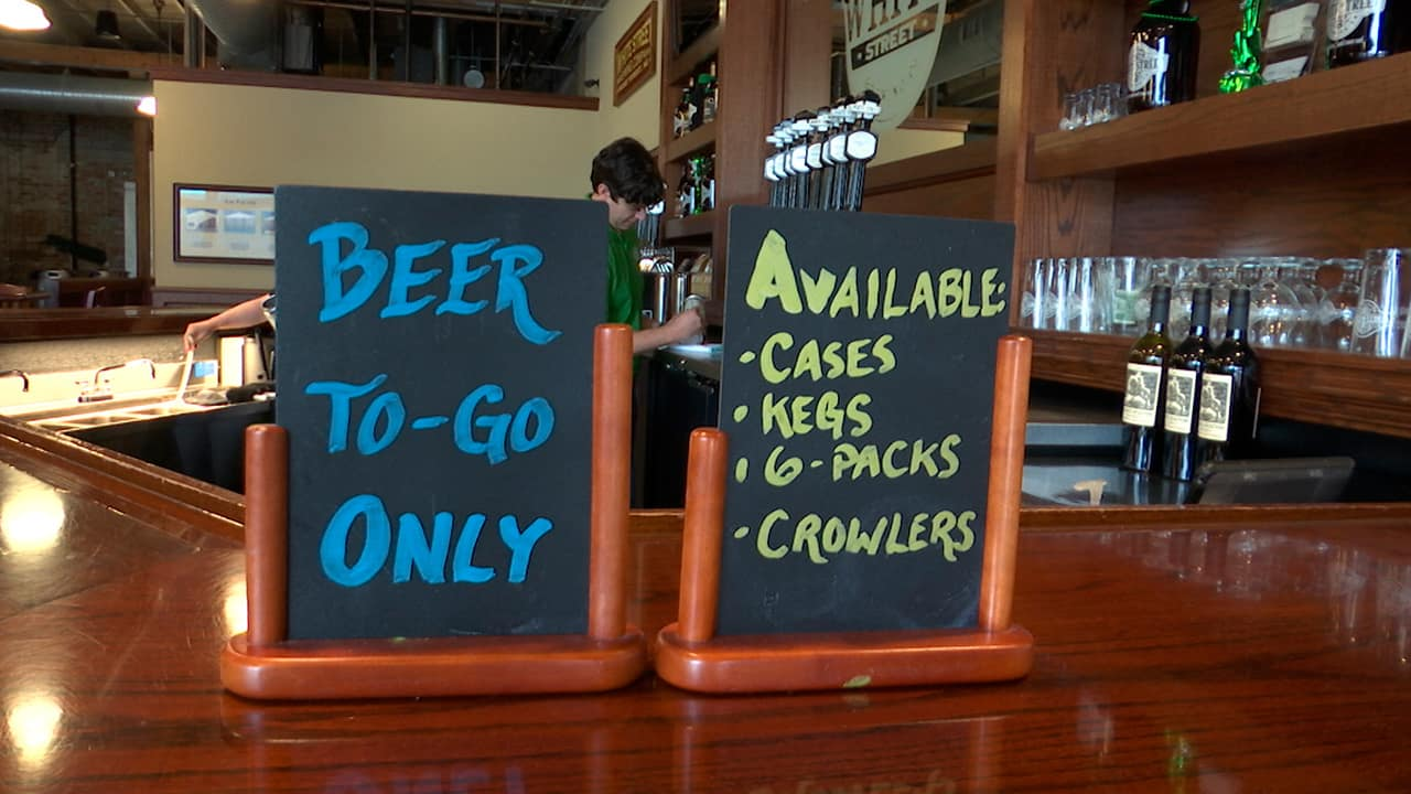Photo of a to-go beer sign