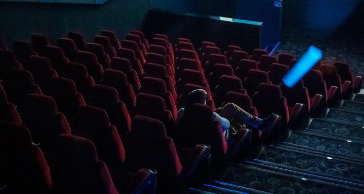 Photo of a man in a movie theater
