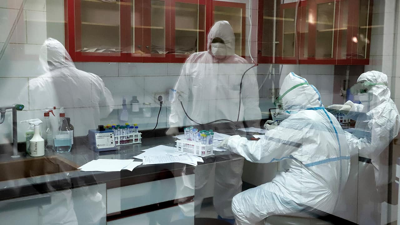 Photo of paramedics testing samples taken from patients suspected of being infected with the new coronavirus