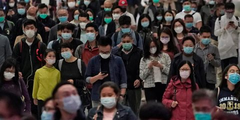 Photo of people wearing protective masks in Hong Kong