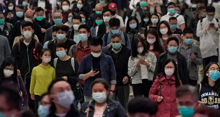Photo of people wearing protective masks in Hong Kong