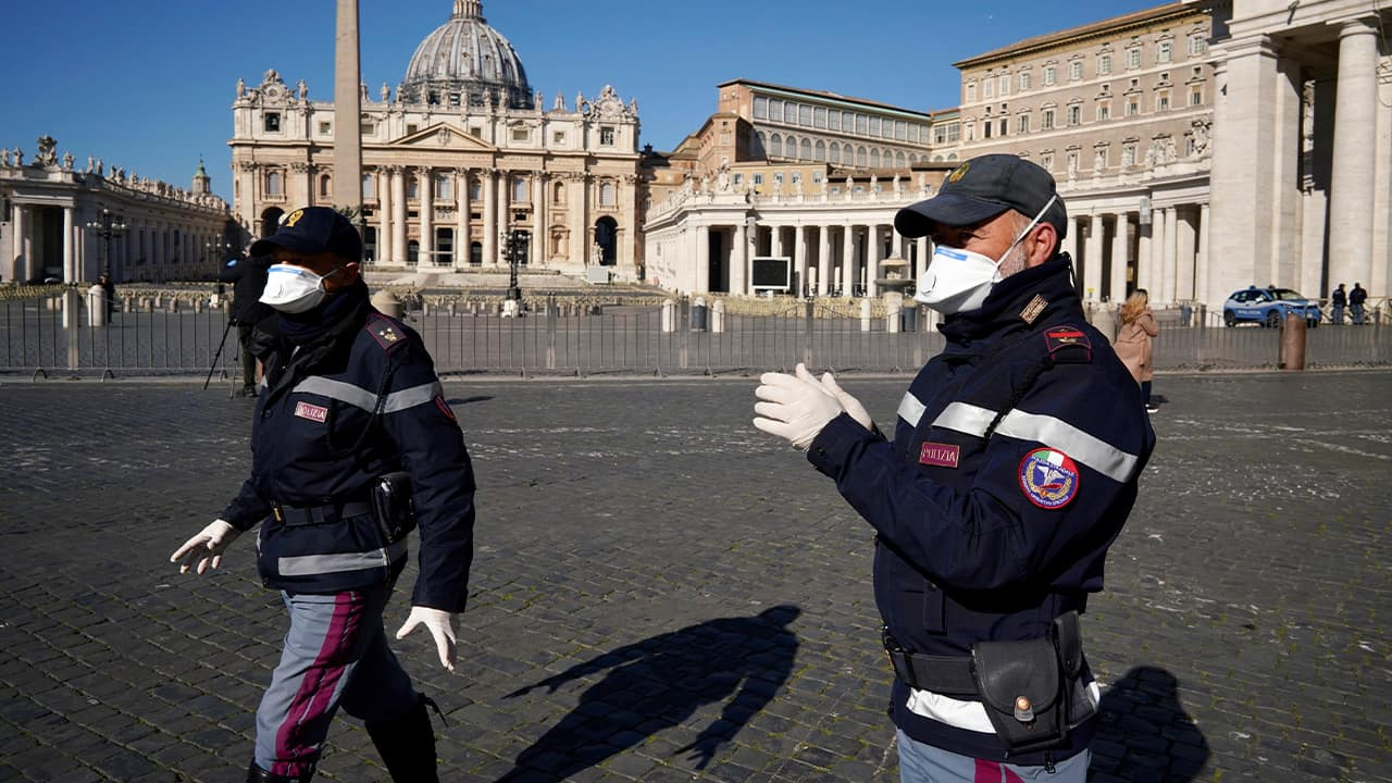 Photo of police officers wearing masks at the Vatican