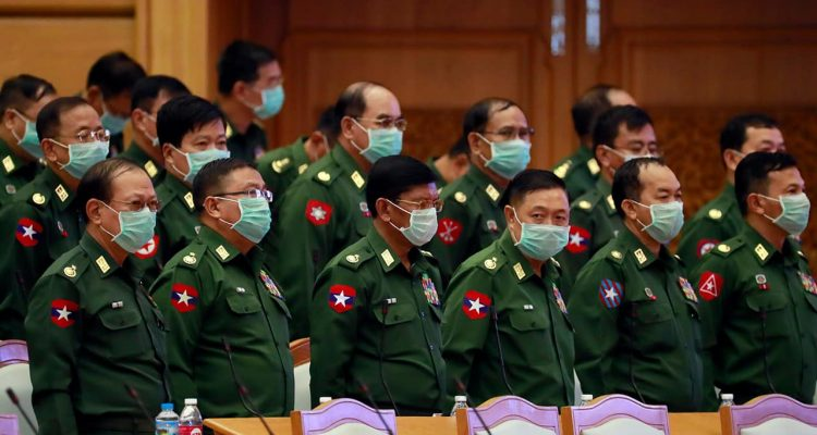 Photo of military representatives wearing masks