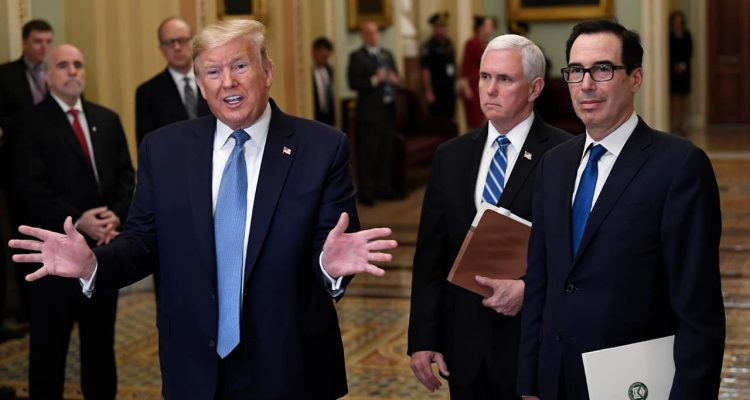 Photo of President Donald Trump, left, standing with Vice President Mike Pence and Treasury Secretary Steven Mnuchin
