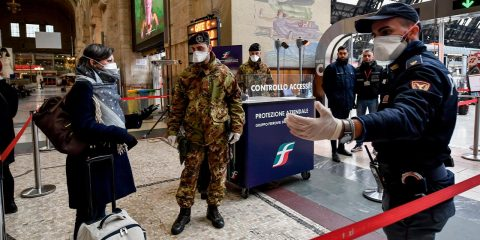 Photo of officers and soldiers checking passengers leaving from Milan main train station, Italy