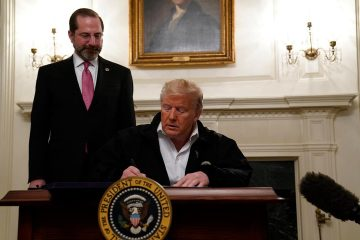 Photo of President Donald Trump signing an $8.3 billion bill to fight the coronavirus outbreak in the U.S.