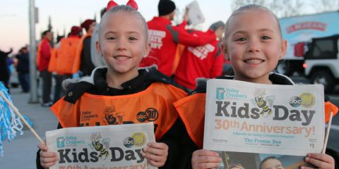 Photo of kids with Kids Day newspapers