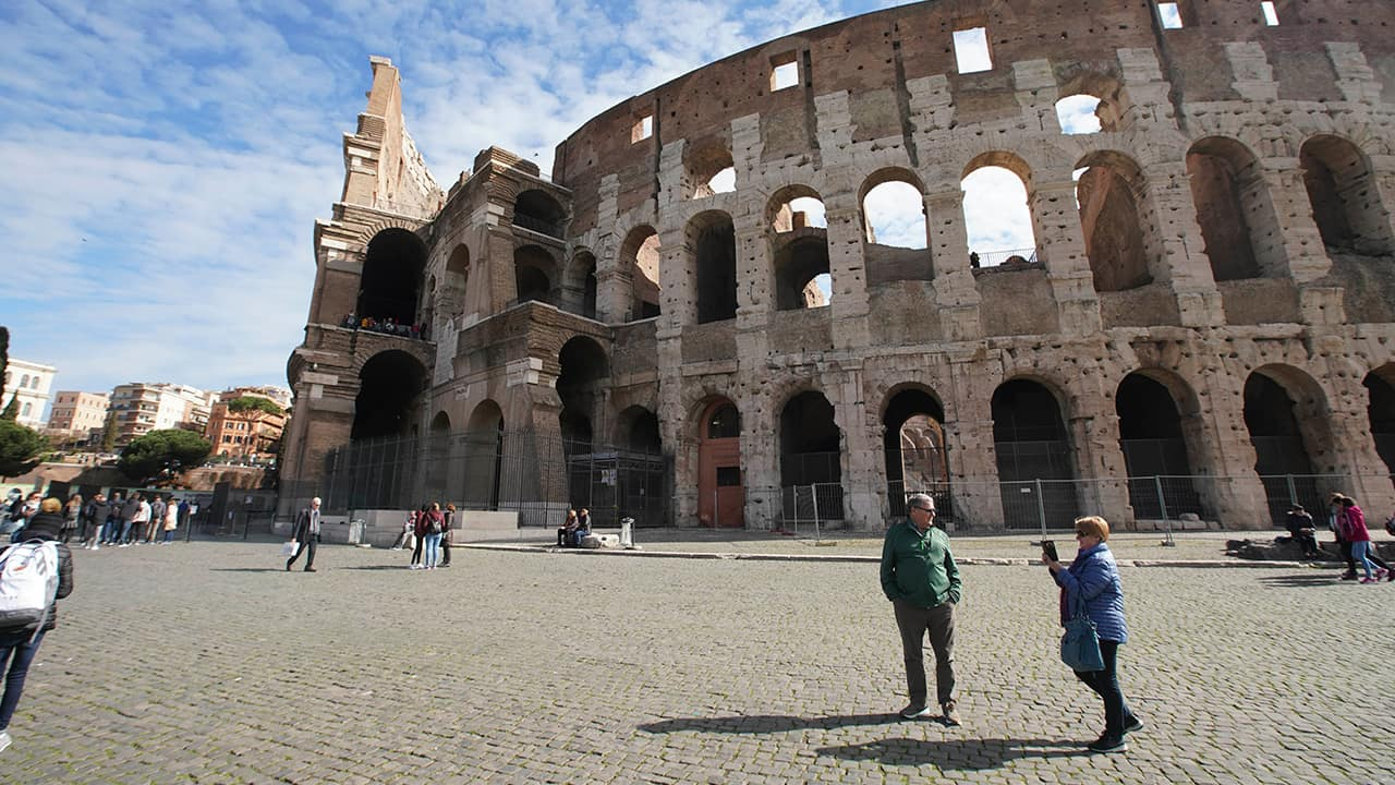 Photo of people by the Colosseum in Rome