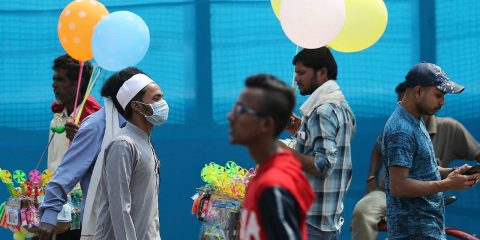 Photo of people wearing face masks in India