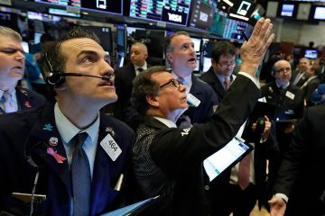 Photo of traders on the floor of the New York Stock Exchange