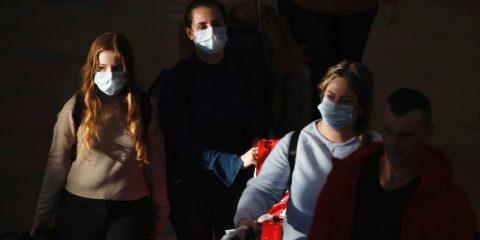 Photo of travelers wearing masks in Tel Aviv, Israel