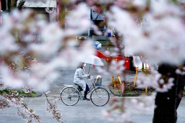 Photo of a woman riding her bike in Tokyo
