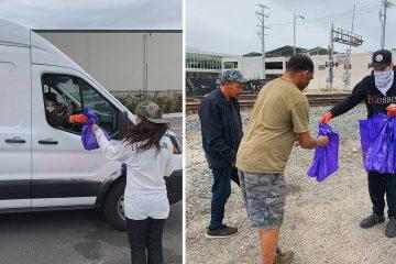 Photo of Elijah Daniel handing out supplies to LA's homeless population