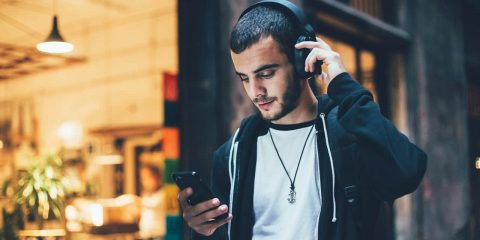 Photo of a man wearing headphones