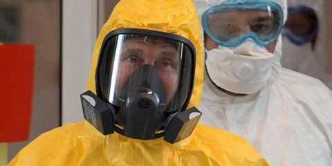 Photo of President Vladimir Putin wearing a protective suit