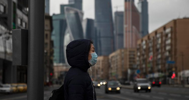 Photo of a woman wearing a face mask in Russia