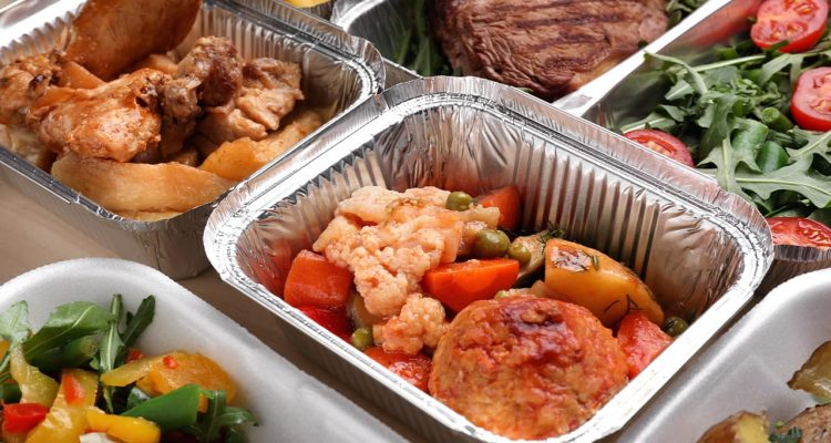 Photo of different types of food in aluminum catering containers