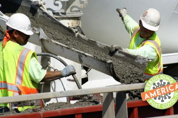 Construction workers pour concretecomposite