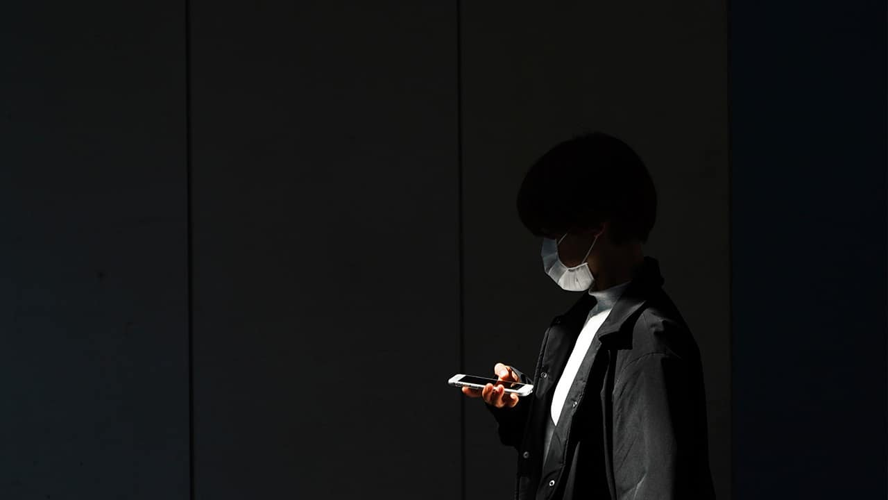 Photo of a woman looking at her phone