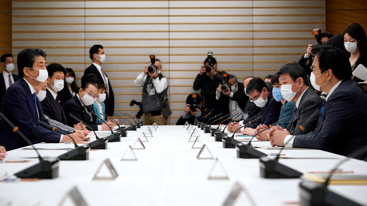 Photo of a meeting of the headquarters for measures against the coronavirus disease at the prime minister official residence in Tokyo, Japan