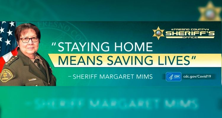 Photo of COVID-19 billboard featuring Fresno County Sheriff Margaret Mims