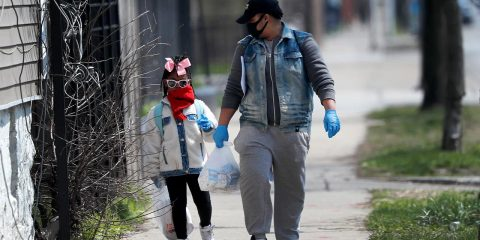 Photo of Erica Harris walking with her daughter in Chicago