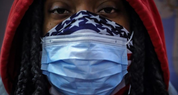 Photo of a woman wearing a face mask in New York