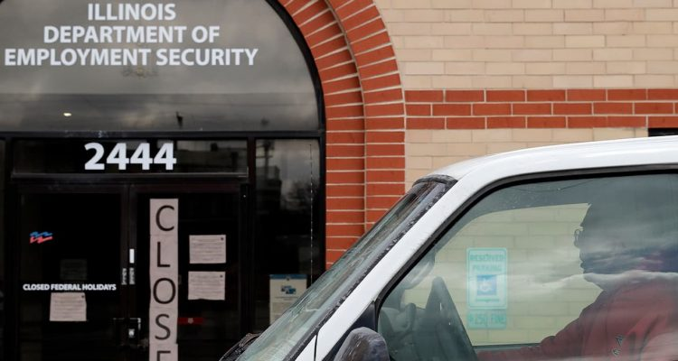 Photo of the closed sign in front of Illinois Department of Employment Security in Chicago