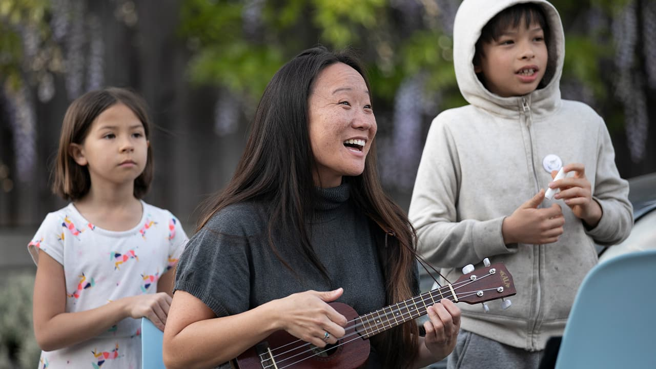 Photo of Patti Wang-Cross playing her ukulele