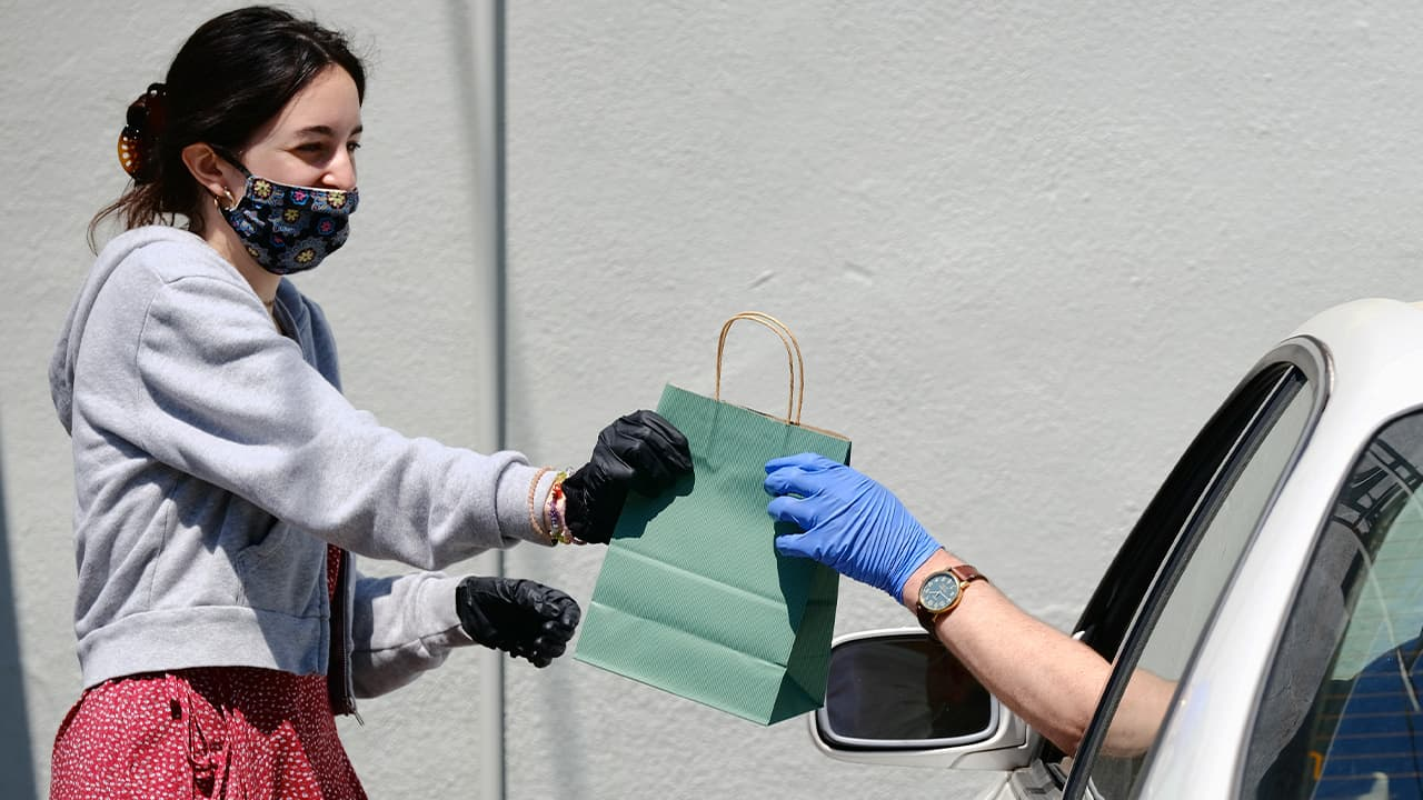 Photo of a woman delivering cannabis products