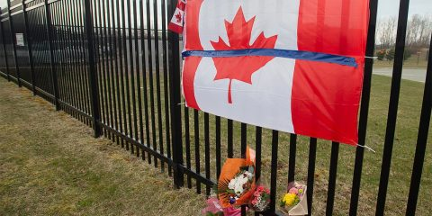 Photo of a Canadian flag at a tribute in Nova Scotia