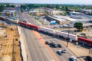 Aerial view of diagonal BNSF train crossing at Blackstone and McKinley avenues in Fresno, California
