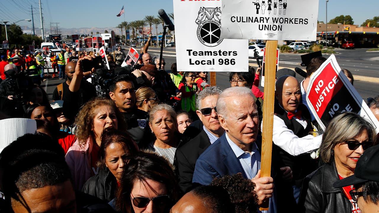Photo of Joe Biden walking on a picket line