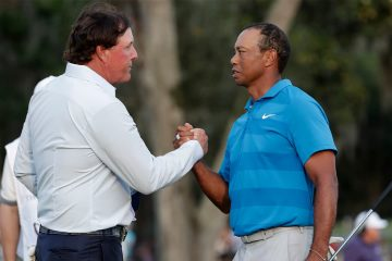 Photo of Phil Mickelson and Tiger Woods