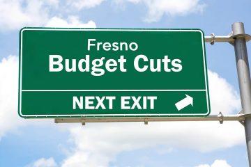 A freeway exit sign that says Fresno Budget Cuts