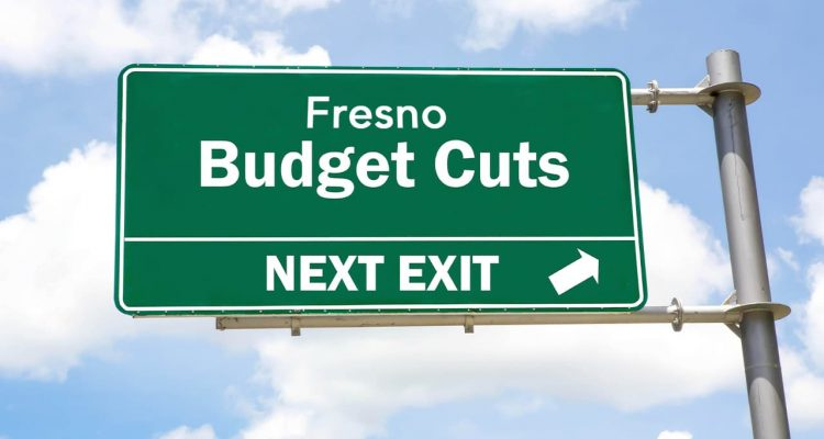 A freeway exit sign that says Fresno Budget Cuts